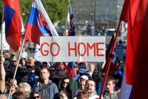 "TOPSHOTS Participants hold flags and a banner during an anti-immigration rally organised by an initiative called ""Stop Islamisation of Europe"" and backed by the far-right ""People's Party-Our Slovakia"" on September 12, 2015 in Bratislava, Slovakia. AFP PHOTO / Samuel Kubani"