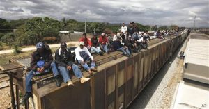 Migrants ride on top of a northern bound train toward the US-Mexico border in Ixtepec, in Oaxaca, southern Mexico, Thursday, March 10, 2011. The Mexican Senate approved last Feb. 24 a bill offering undocumented migrants greater rights, while stripping out controversial proposals to toughen enforcement measures. Migrants crossing Mexico to get to the U.S. have increasingly become targets of criminal gangs who kidnap them to obtain ransom money. (AP Photo/Eduardo Verdugo)