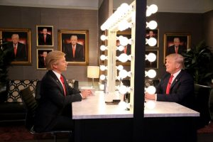 "In this image released by NBC, host Jimmy Fallon, left, and Republican presidential candidate Donald Trump appear in the ""Trump in the Mirror"" skit during a taping of ""The Tonight Show Starring Jimmy Fallon,"" on Friday, Sept. 11, 2015, in New York. (Douglas Gorenstein/NBC via AP) ORG XMIT: NYET562"