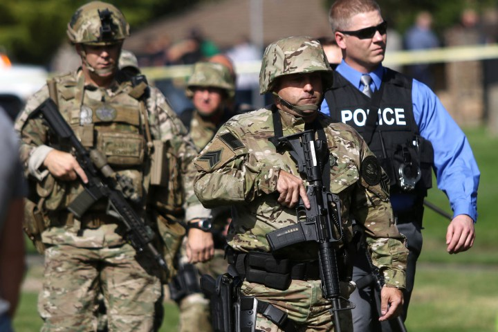 Authorities respond to a report of a shooting at Umpqua Community College in Roseburg, Ore., Thursday, Oct. 1, 2015. (Michael Sullivan/The News-Review via AP) MANDATORY CREDIT