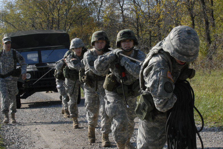 The nine female Ball State University ROTC team works together during the Humvee pull event during the Ranger Challenge held at Camp Atterbury, Ind., Oct. 25. The three day event was a team building and leadership skills oriented competition.