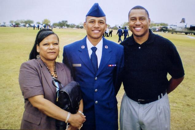 Anthony Hill, shown in his Air Force uniform with family members, was diagnosed with bipolar disorder while serving, his friends have said.